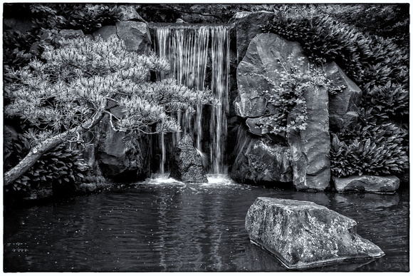 Japanese garden waterfall in black and white minnesota landscape arboretum